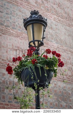 A Lamp Post Decorated With Flowers At Malaga, Spain, Europe