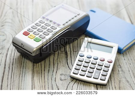 Modern Technology And People Concept - Pos Terminal, A Notepad And Calculator. Rough Bords Backgroun