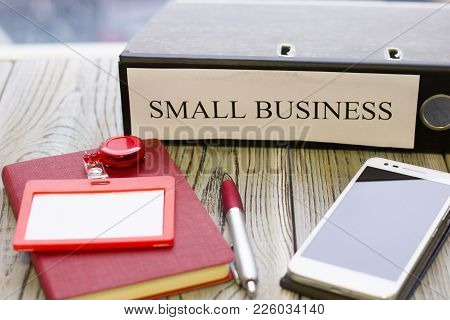 Planning Business Concept - Small Business Documents, Notepad And Telephone. Rough Bords Background.