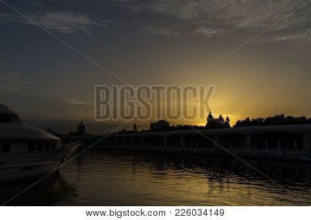 The Docking Harbour Of Malaga With Sun Set In The Background In Malaga, Spain, Europe