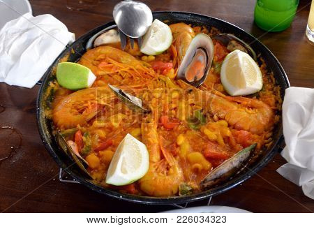 Fresh Paella Served On A Casserole. Traditional Spanish Cuisine.