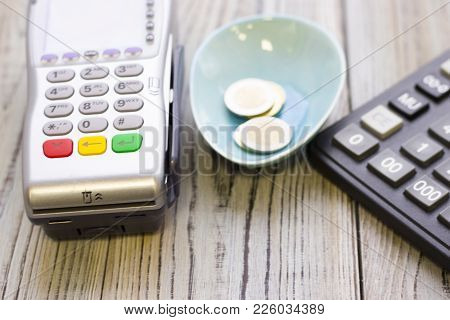 Modern Technology And People Concept - Pos Terminal And Calculator. Rough Bords Background. Closeup