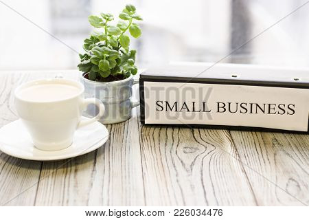 Planning Business Concept - Small Business Documents And A Cup Of Coffee. Rough Bords Background. Cl