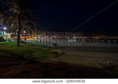 The Malagueta Beach At Night Time In Malaga, Spain, Europe