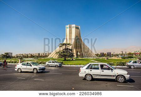 Tehran, Iran - October 15, 2016: Cars On The Stree In Front Of Famous Teheran Landmark Azadi Tower O
