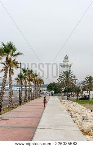 The Lighthouse At Malagueta Beach In Malaga, Spain, Europe