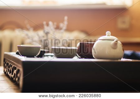 Exquisite Hot Tea In Teapot At Traditional Chinese Tea Ceremony. Set Of Equipment For Drinking Tea.