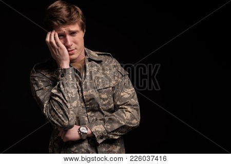 Despondent Military Man Looking At Camera And Standing With Suffering Look. Concept Of Despair. Isol