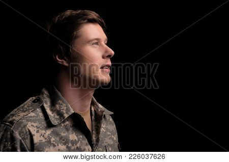 Hopeful Military Man Looking Up With Belief. Concept Of Hope. Isolated On Background. Copy Space In
