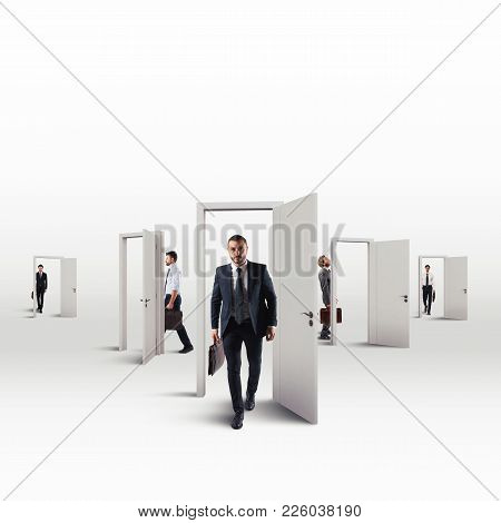 Businessmen Choose The Right Door That Leads To Success