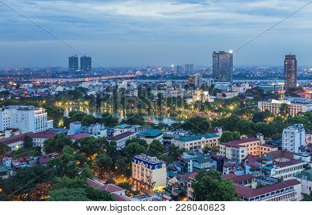 Aerial View Of Hanoi Cityscape At Twilight. Viewing From Ly Thuong Kiet Street, South Of Hoan Kiem L