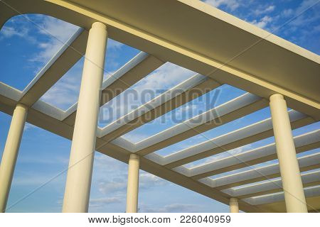 Details Of Building Roof With Cement Lines Against Blue Sky