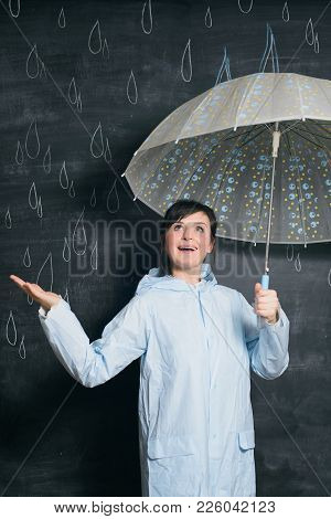 White Caucasian Woman In Blue Raincoat Under Umbrella With Chalk Hand Drawn Raindrops Background