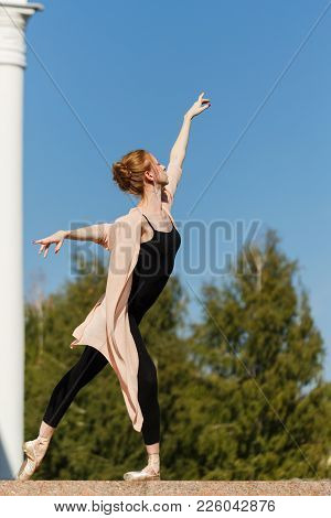 Young Graceful Ballerina Dancing At The Building. Beauty And Grace Of The Body. Ballet Pas. Street P