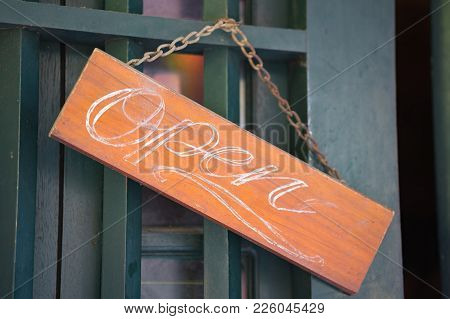 Wooden Open Sign On Entrance Door. Welcome Sign