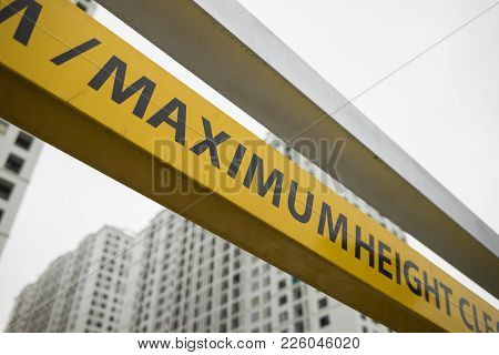 Maximum Height Sign With Apartment Building On Background