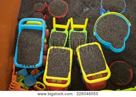 Kid colourful toys with man made safe sand from cassia tora seed poster