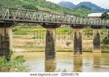 Old Bridge Crossing River In Tay Nguyen, Central Highlands Of Vietnam