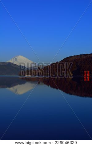 Inverted Mt. Fuji And The Torii Of Peace With Blue Sky Sunny From Lake Ashi Hakone Japan 02/09/2018