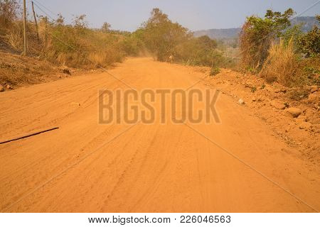 Dirty Red Road In Tay Nguyen, Central Highlands Of Vietnam