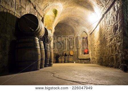 Wine Barrels In Cellar. Wine Storage Place