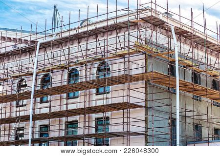 Scaffolding On Wall Of The Building For Renovation Of Facade