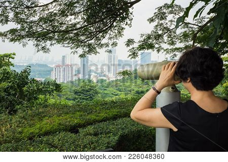 Tourist Seeing Singapore Cityscape By Binoculars From Mount Faber Hill Top