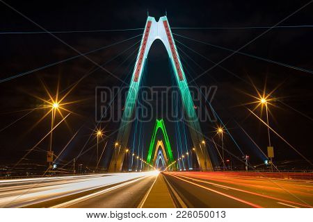 Long Exposure Nhat Tan Cable Stayed Bridge At Night. The Bridge Crossing Red River.