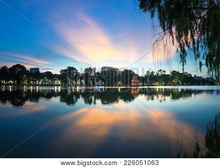Hoan Kiem Lake Or Ho Guom, Sword Lake, The Center Of Hanoi Capital, Vietnam At Twilight. Willow Bran