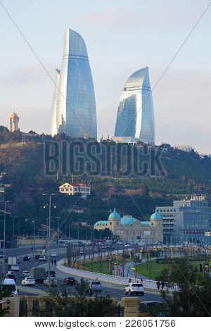 Baku, Azerbaijan - December 29, 2017: Flame Towers Above The Neftchilar Avenue On The Morning Of Dec