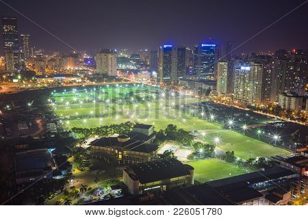 Aerial View Of Football Grounds In Hanoi At Night. Cau Giay District