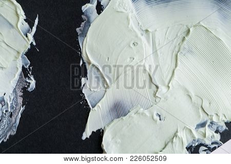 Smear Clay Mask For Face And Body. Texture Is Smeared Isolated On A Black Background. Natural Produc