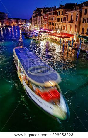 Venice, Italy - May 21, 2017: Beautiful View Of The Grand Canal In Venice With Vaporetto Crossing It
