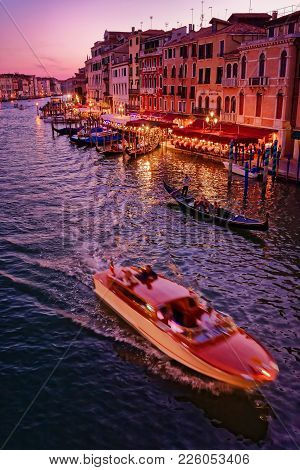 Venice, Italy - May 21, 2017: Beautiful View Of The Grand Canal In Venice With A Small Boat Crossing
