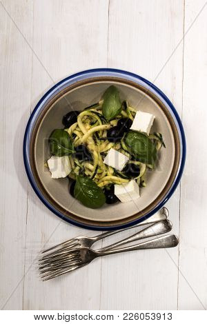 Courgette Salad With Feta Cheese, Black Olive And Basil