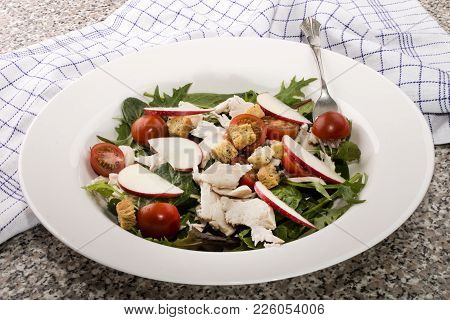 Healthy Salad With Tomato, Radish, Cooked Chicken Meat And Croutons On A Plate