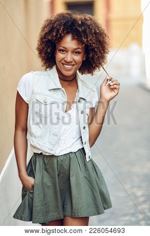 Young Black Girl, Afro Hairstyle, Smiling In Urban Background