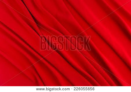 Deep Red Silk Smooth Background With Copy Space. Abstract Passion Love Backdrop.
