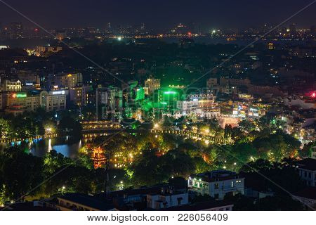 Aerial View Of A Corner Of Hoan Kiem Lake Or Sword Lake, Ho Guom In Vietnamese At Sunset Time. Hanoi