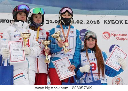 KRASNOE OZERO, LENINGRAD REGION, RUSSIA - FEBRUARY 1, 2018: Winners in dual mogul of Freestyle Europa Cup during award ceremony. From left: Lundblad, Sweden, Smirnova, Kuznetsova, Bezgodova, Russia