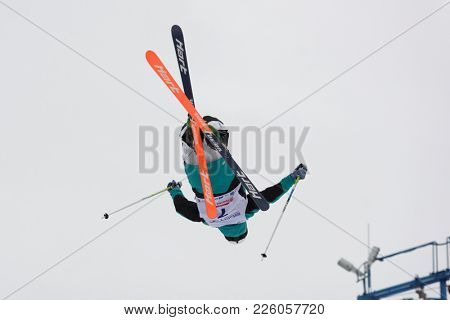 KRASNOE OZERO, LENINGRAD REGION, RUSSIA - FEBRUARY 1, 2018: Michail Dolmatov of Russia competes in dual mogul during Freestyle Europa Cup competitions. Dolmatov takes 8th place