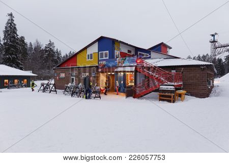 KRASNOE OZERO, LENINGRAD REGION, RUSSIA - FEBRUARY 1, 2018: People in ski resort Krasnoe Ozero during Freestyle Europa Cup. Athletes from 7 countries participate in competitions