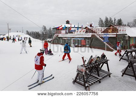 KRASNOE OZERO, LENINGRAD REGION, RUSSIA - FEBRUARY 1, 2018: Athletes at the start of dual mogul competitions during Freestyle Europa Cup. Athletes from 7 countries participate in competitions