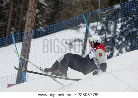 KRASNOE OZERO, LENINGRAD REGION, RUSSIA - FEBRUARYy 1, 2018: Nikita Novitckii of Russia falls in dual mogul competitions during Freestyle Europa Cup. He takes 15th place