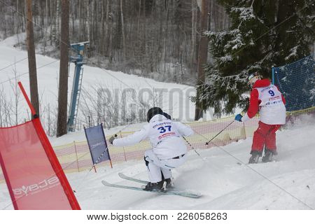KRASNOE OZERO, LENINGRAD REGION, RUSSIA - FEBRUARY 1, 2018: Anton Axellie (37) of Sweden and Ilya Chevskiy of Russia compete in dual mogul during Freestyle Europa Cup competitions. Chevskiy won bronze
