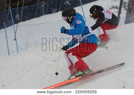 KRASNOE OZERO, LENINGRAD REGION, RUSSIA - FEBRUARY 1, 2018: Ksenia Kuznetsova (blue) and Anastasiya Pervushina, both of Russia, compete in dual mogul during Freestyle Europa Cup competitions