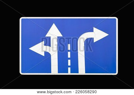 'direction To Be Followed' Old Square Blue Road Sign Isolated On Black