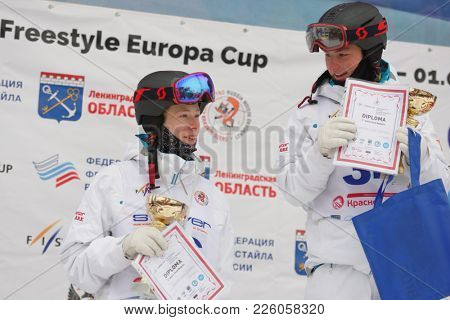 KRASNOE OZERO, LENINGRAD REGION, RUSSIA - FEBRUARY 1, 2018: Oskar Elofsson (right) and Albin Holmgren, both of Sweden, during award ceremony of dual mogul competitions during Freestyle Europa Cup