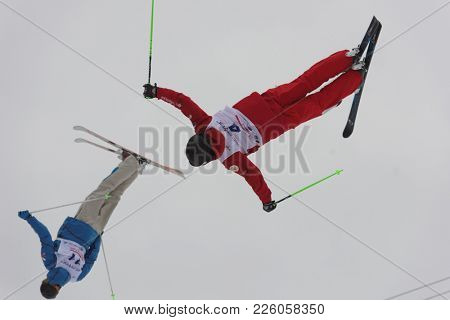 KRASNOE OZERO, LENINGRAD REGION, RUSSIA - FEBRUARY 1, 2018: Timur Rakhmatullin (4) and Evgenii Gedrovich, both of Russia, compete in dual mogul during Freestyle Europa Cup competitions