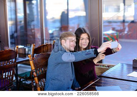 Medical Students Using Silver Smartphone To Take Selfie At Cozy Cafe, Young People Celebrating Profe